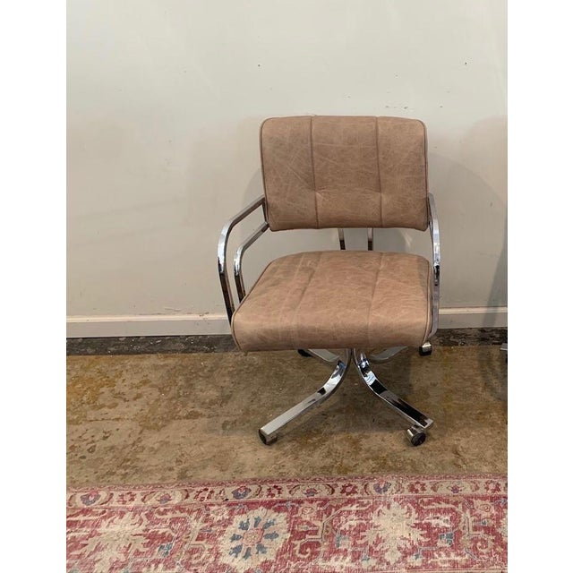 This fabulous 1980s chrome base swivel rocker desk chair has been reupholstered in a mushroom leather w/lightly distressed...