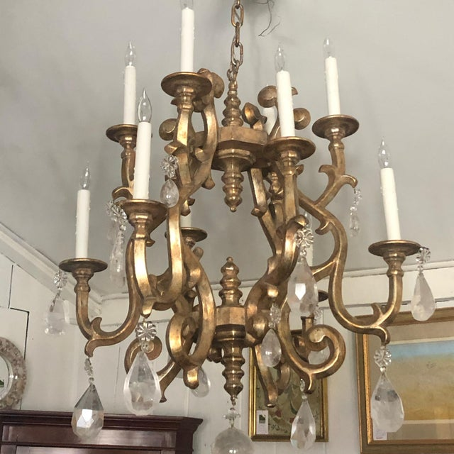 Fabulously stylish contemporary designer giltwood multi arm chandelier with big glamorous rock crystals. Note: Pair of...