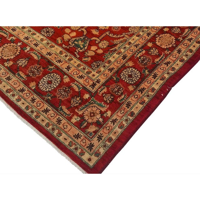 This beautiful reddish rust handmade rug is intricately designed to create a beautiful mesmerizing soothing ambience in...