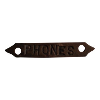 "World's Tiniest Brass ""Phones"" Sign"
