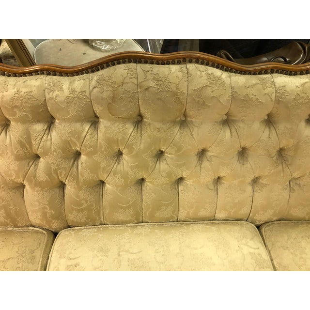 Lovely Queen Anne sofa in a cream damask fabric. Button tucked back with nail head trim. Neutral color fabric allows for...