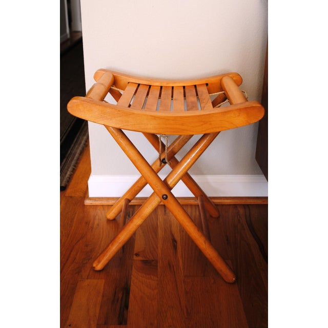 Mid-Century folding camp stool with rope handle in a very practical design. Rope handle remains under the stool until it...