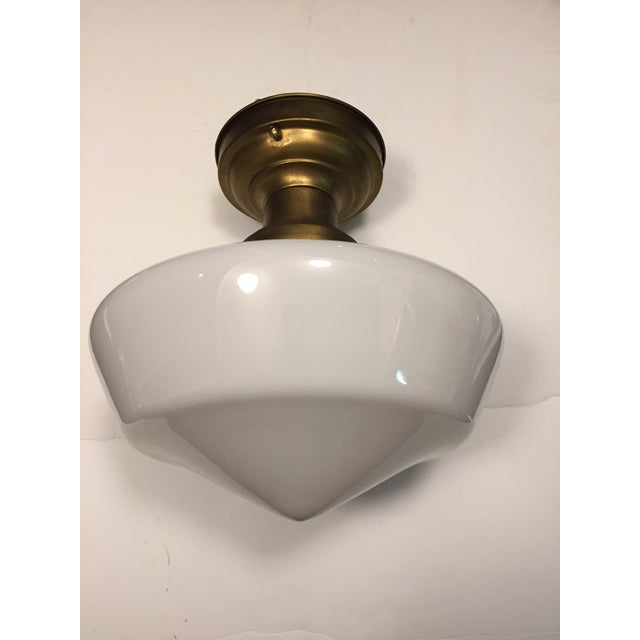 Old Lights On is pleased to offer this vintage brass flushmount fixture and schoolhouse shade. It has been rewired and is...