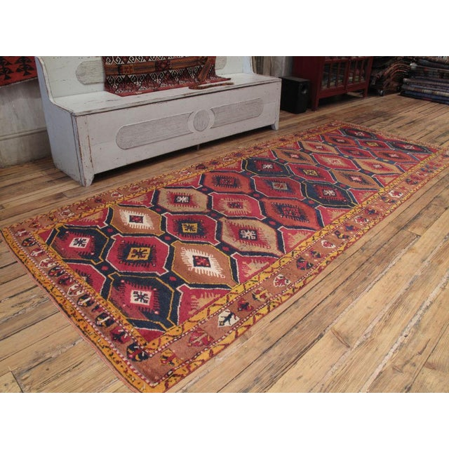 A great old village rug from Central Turkey. Shows its age but still sturdy and very charismatic.