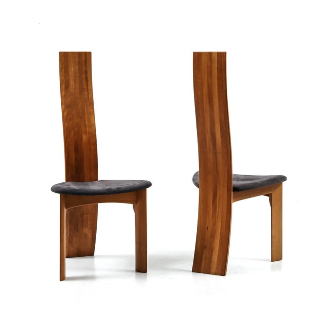 A set of eight Danish cherry wood dining chairs. Designed 1970 by Bob og Dries van den Bergh for Tranekær Mobler....
