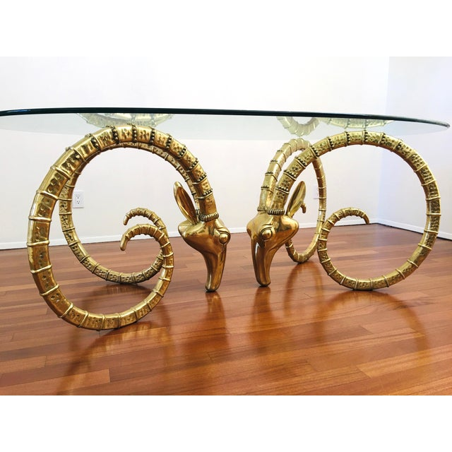 Vintage Brass Rams Head Dining Table. In the style of Alain Chervet. 2 huge ram heads with oval glass top. Can seat from 4...