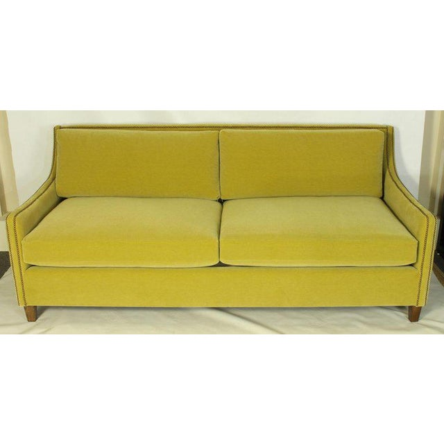 A Classic yet contemporary custom designed deep-seated sofa covered in an S. Harris citron green wool mohair fabric...