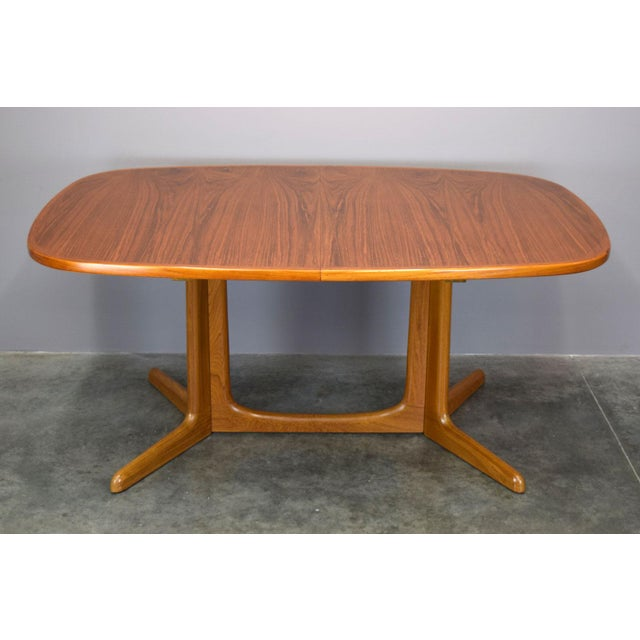 This gorgeous, sculptural, expandable dining table is usually attributed to Niels O. Moller, but we have not confirmed the...