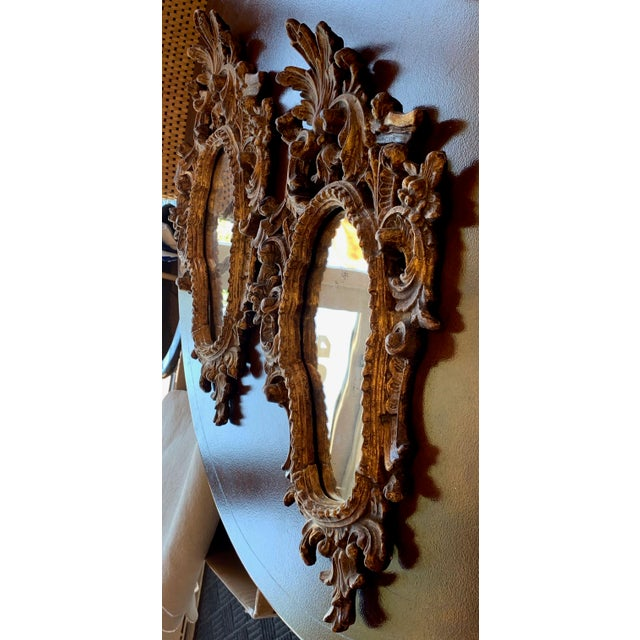 Pair of Italian Rococo style accent mirrors. Molded and carved gesso atop hand carved soft wood. Gold leaf finish. No...