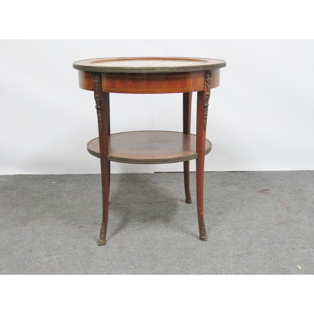 Grosfeld French style specimen marble top center table , satinwood with inlaid floral designs , ormolu mounts on legs and...