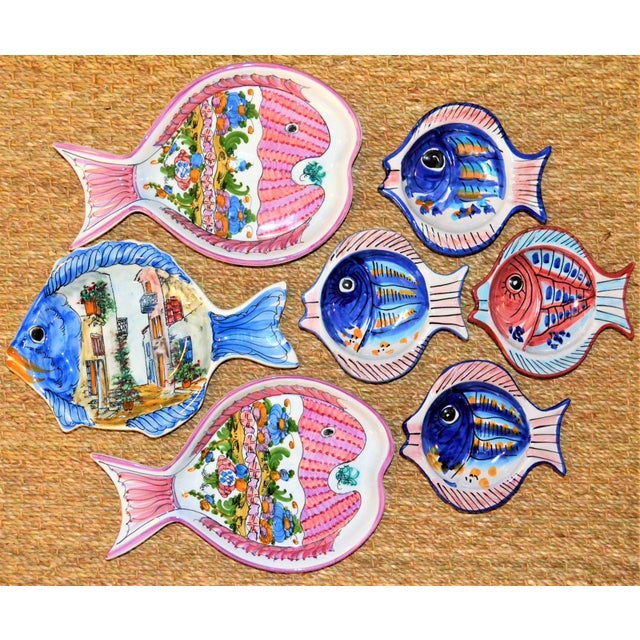 This is a vintage collection of Mediterranean majolica pottery. These are hand painted pescado pottery plates and dishes....