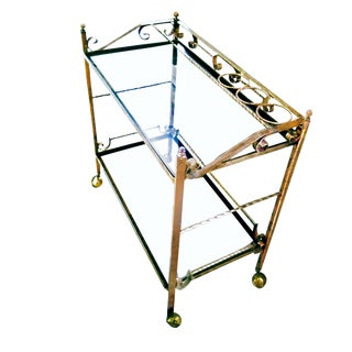 Vintage Palm Springs Regency Two Tier Gold Leafed Wrought Iron Rolling Bar Cart For Sale