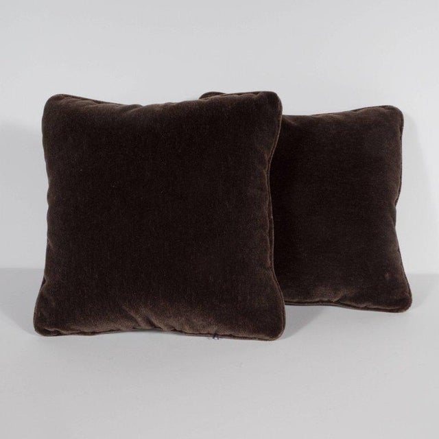 This stunning pair of square pillows have been upholstered in a luxe chestnut brown mohair. Their austere form and...