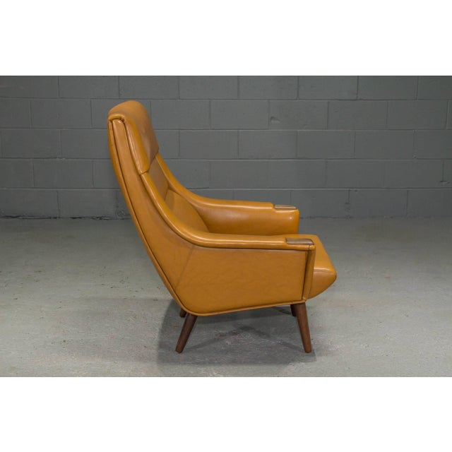 High Back Lounge Chair in Caramel Vinyl. This lounge chair is in all-original condition and is very comfortable.