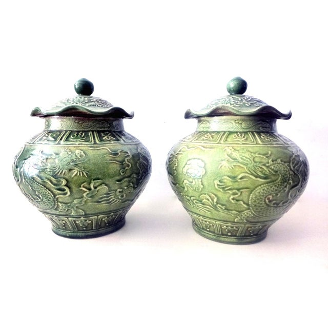 Beautiful pair of Chinese celadon ginger jars with dragon decoration. The surface was made in green cracked celadon. One...