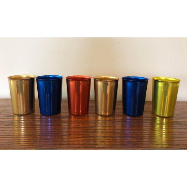 Fun set of vintage tumblers in primary colors. Smaller size that is hard to find.