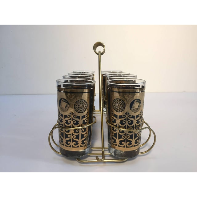 Elegant exquisite vintage set of eight Collins glasses designed by Fred Press. Set includes eight highball glasses in a...