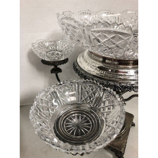 Exquisite vintage silver plate epergne with crystal bowls. Bowls are clear with no scratches or chips. This piece is in...