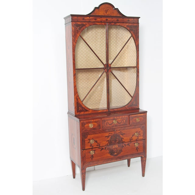 A fine English George III satinwood and inlaid bookcase, attributed to Gillows. Mahogany veneered diminutive two-part...