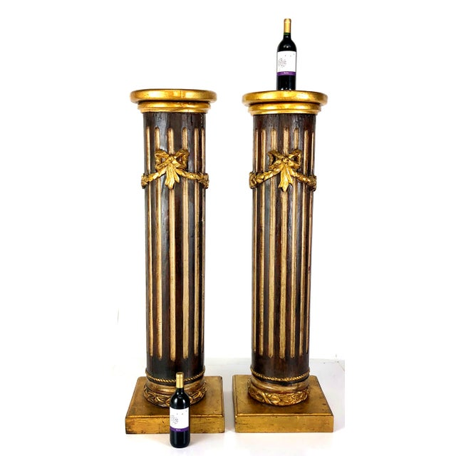 An absolutely fantastic pair of antique French 19th century Louis XVI / Neoclassic finely carved giltwood columns. Each is...