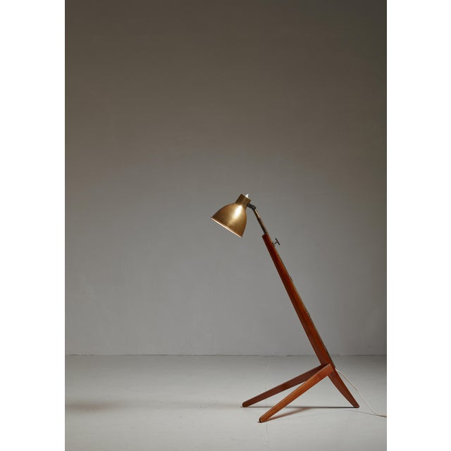 A rare Mitragliera ('machine gun') floor lamp by Italian architect and designer Franco Albini, made of a cherrywood base...