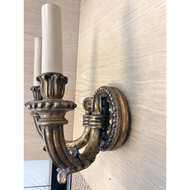 Traditional Wood Carved 1920's Vintage Two Arms Antique Gilded Wall Sconces. This wall sconce came out of an old theater...