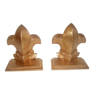 Gilt Fleur De Lis Bookends - A Pair For Sale
