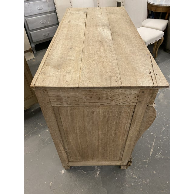 19th. C. French Empire bleached oak commode with bronze pulls and escutcheons. Consists of four drawers, flanked by...