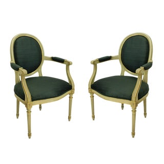 A Pair of French Painted & Gilded Armchairs For Sale