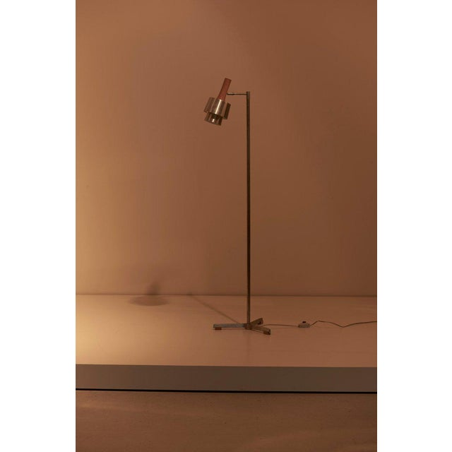 Floor or reading lamp designed by Jo Hammerborg for Fog & Mørup in steel with a three divided stand. To be on the safe...