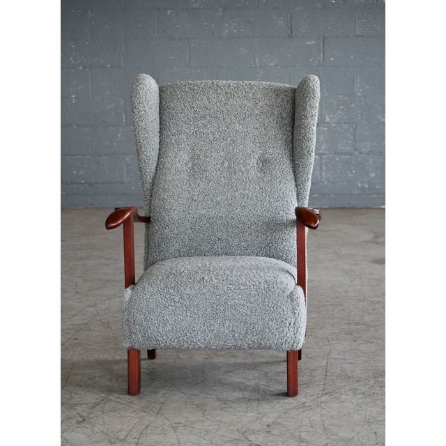 Very cool low swung wing back lounge chair made by Fritz Hansen in Copenhagen, Denmark. Great dramatic angles and...
