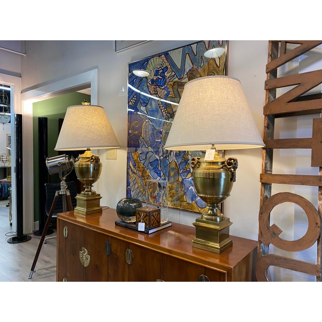 Stunning vintage chapman lamps designed to look like a trophy, gorgeous solid brass base.