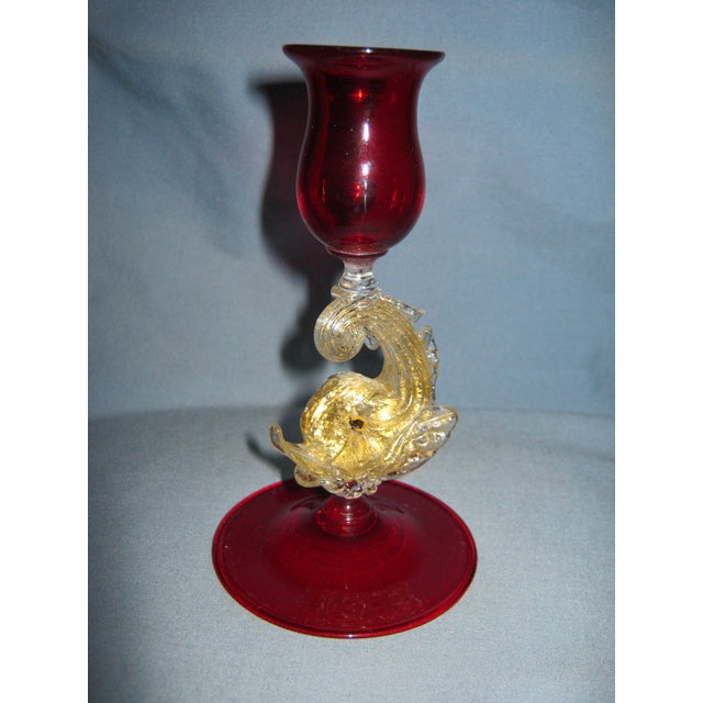 Fabulous vintage ruby hand blown candlestick with a large dolphin in clear glass and lots of gold aventurine. The piece is...