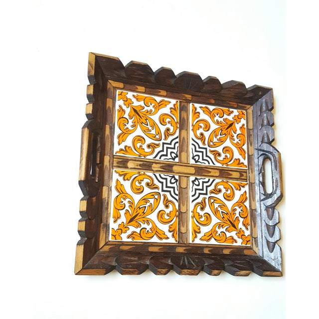 A vintage 70s hand carved wood serving tray which is beautifully detailed and has four ceramic, Mexican tiles framed by...