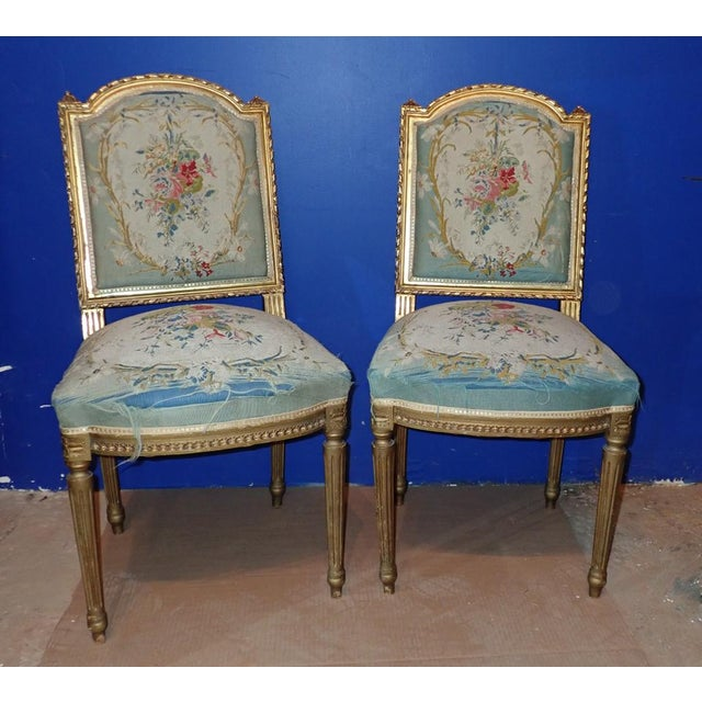 Pair of floral Petit Point Embroidered Chairs, Louis XVI Style. Gilt wood frames.