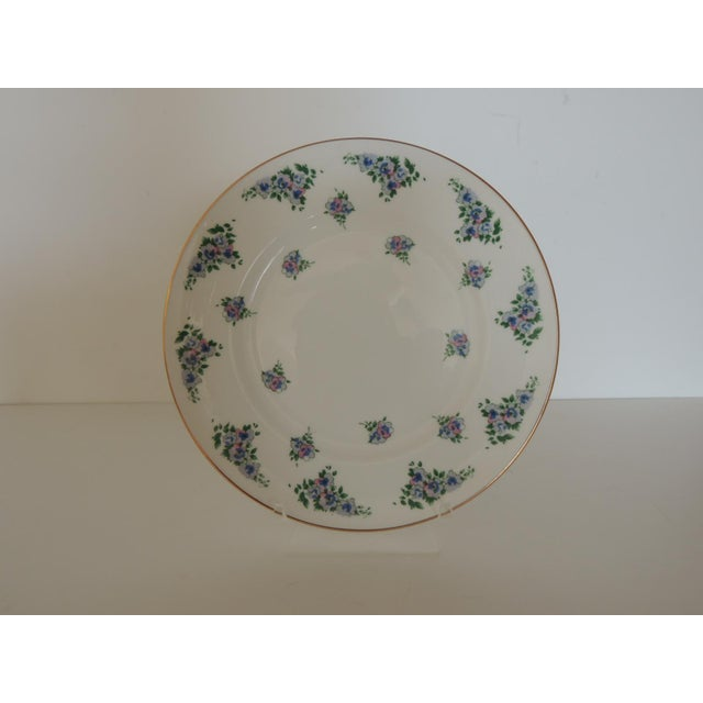 """Floral pattern in green, violet and pink with gold accents. Size: 8.25""""D x. 25""""H"""