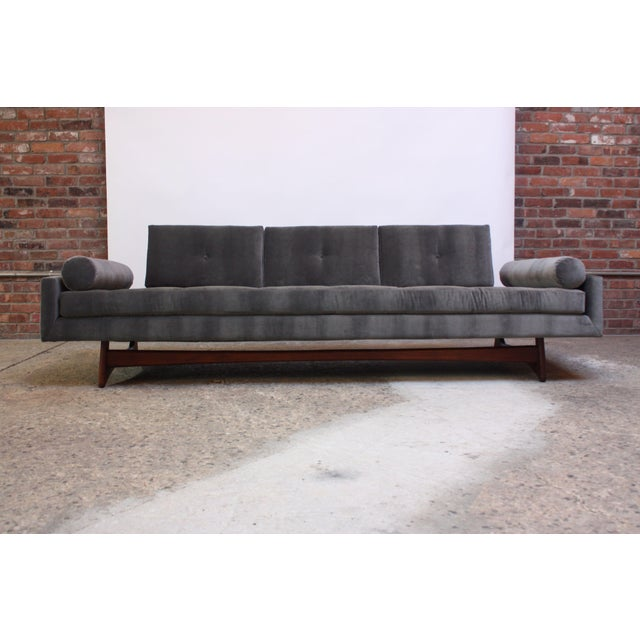 Model #2408 'Gondola' sofa designed by Adrian Pearsall for Craft Associates in the 1960s. Composed of a sculpted walnut...