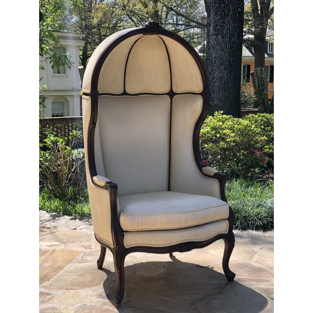 20th Century French Porter's chair created in the Louis XV style with a walnut frame and carved rosette details. The...