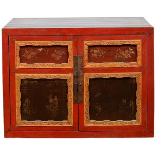 Chinese Vintage Small Red Lacquered Cabinet With Carved and Hand Painted Motifs For Sale