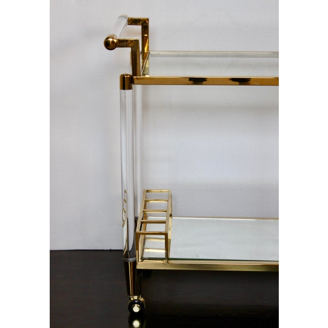Warm gold encases the clean simplicity of clear lucite, so very Charles Hollis Jones. Perfection in your mid-century...