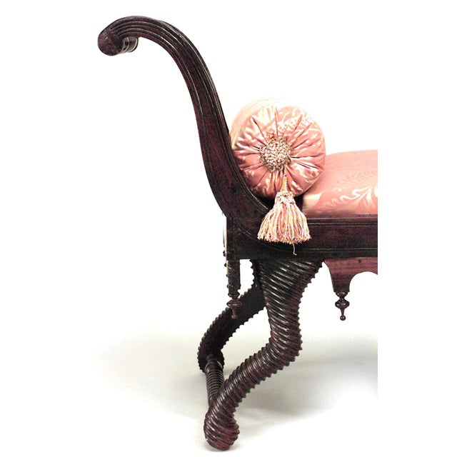 English Regency style 19th Century rosewood chaise with swirl and finial design with rust color upholstery.