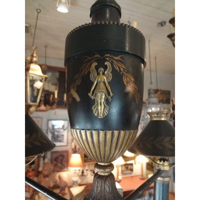 Beautiful bronze chandelier with 4 lights. US wired. Each arm has a tole bonnet. This used to be an oil chandelier....