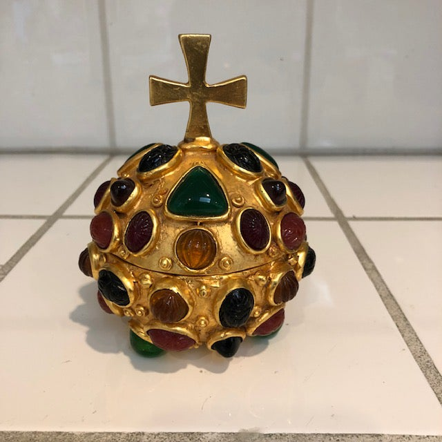 Golden orb with cross top box. Box plated in 24K gold and studded in scarabs, carved radiating ovals and triangular...
