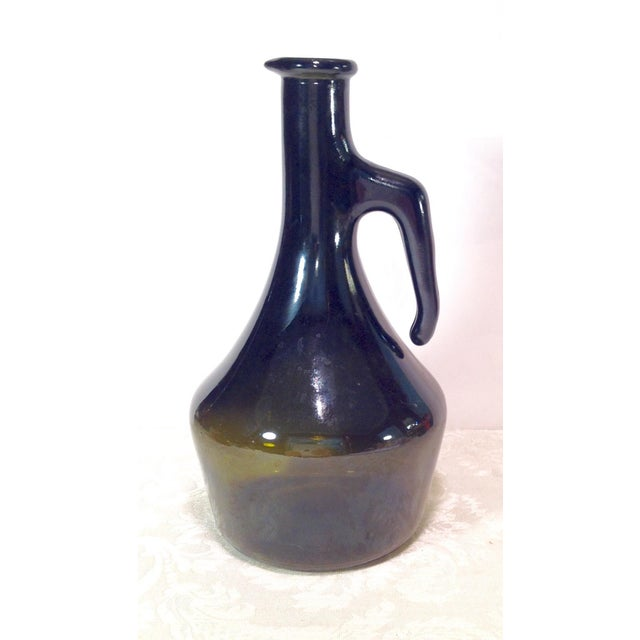 "Nice dark green Italian wine bottle or jug. Marking on base says ""Mod Dep 1000 Italy "" Mod Dep stands for Modele Depose..."