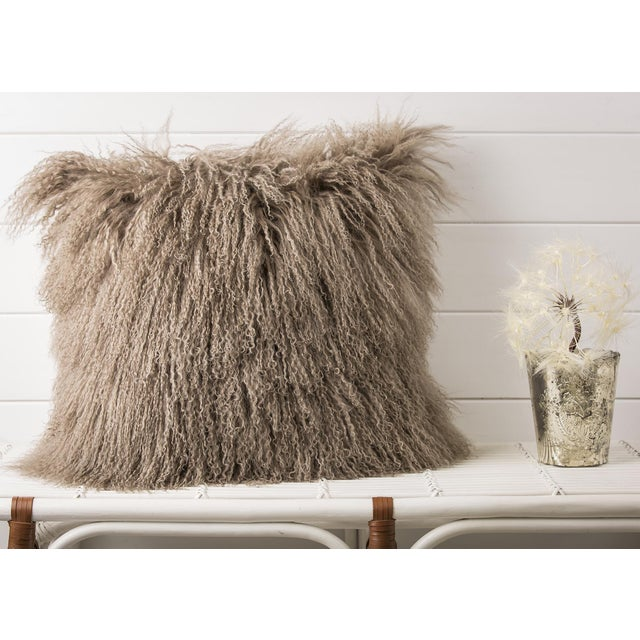 A playful, contemporary and quintessentially feminine spirit that lies at the heart of the Mongolian Fur Pillow.