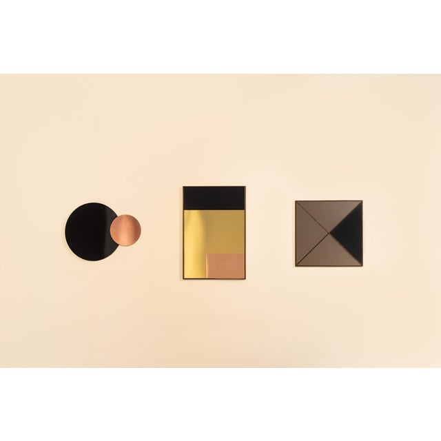 Rectangular Constructivist Mirror x Nina Cho YEAR: 2014 MADE IN: Detroit + Allen Park, MI ABOUT THE DESIGNER: Nina Cho is...