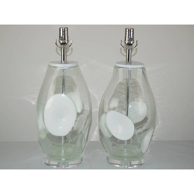 Vintage CLEAR jug-shaped glass table lamps with dimpled 'Bulls Eyes' of WHITE. The Pulegoso technique leaves lots of tiny...