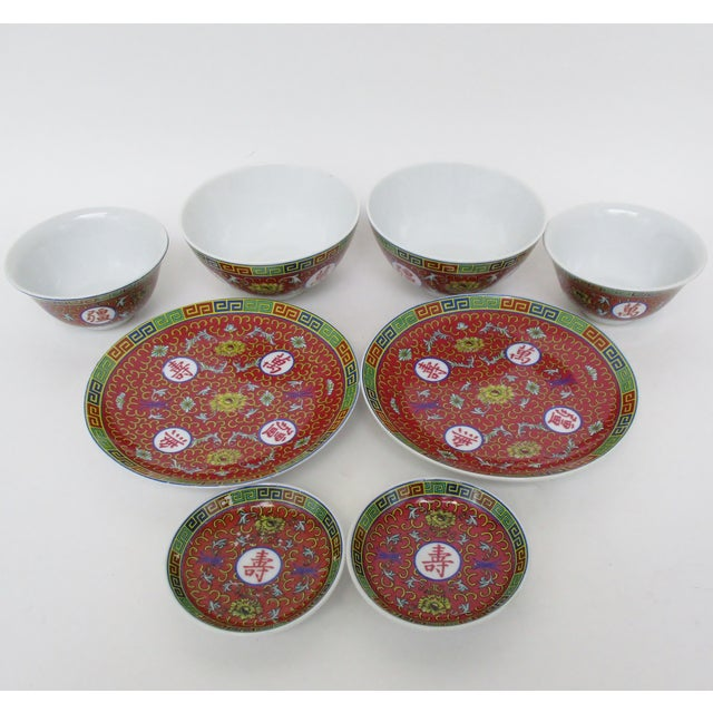 Chinese red-glazed 8-piece porcelain Mun Shou dinnerware, with service for 2. The set includes 2 small plates, 2 rice/soup...