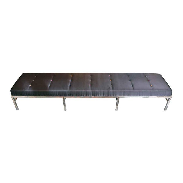Satin cushioned bench with multicolored silk covered buttons and a nickel over steel base. This is a very heavy and sturdy...