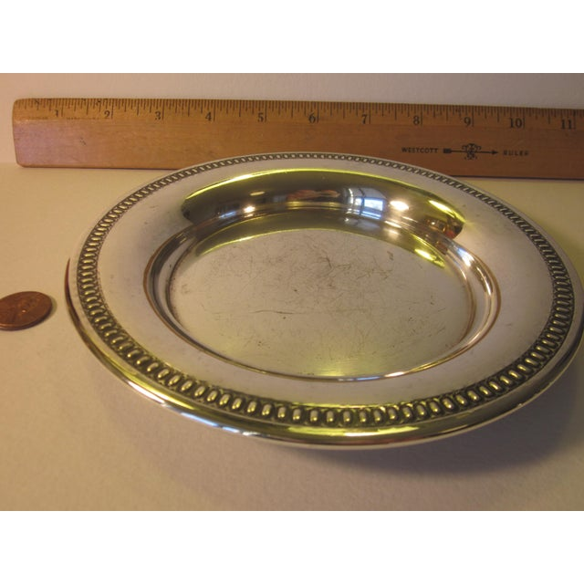 """A small silverplate salver or circular tray with handsome beaded rim, measuring 6.25"""" diameter and .75"""" deep. Marked """"Wm..."""